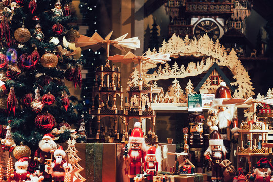 Variety of beautiful and joyous Christmas and New Year toys in the Nuremberg's shop window during holiday season