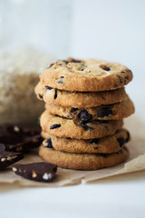 Homemade oatmeal cookies with chocolate, energy sweet snack, vertical closeup
