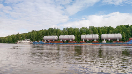 Transportation of industrial goods on the river.