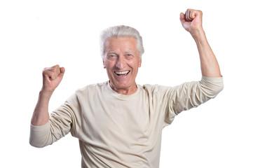 Portrait of happy senior man posing on white background