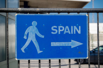 Sign pointing to Spain at the Border in Gibraltar