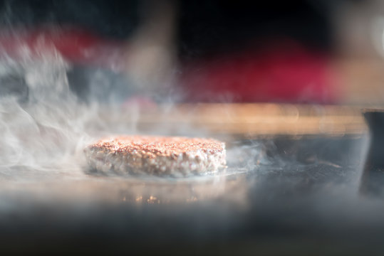 Cutlets from minced meat roasted on the grill. Meat hamburger Patty closeup. Ingredients for Burger. cooking barbecue outside. process of preparation of ingredients for a Burger