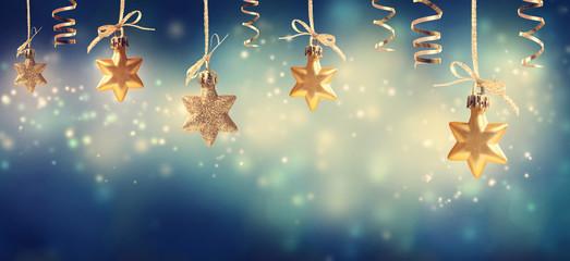 Christmas star ornaments in a snowy night