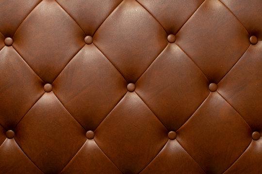 Brown genuine leather sofa background.