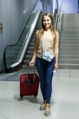 Girl walking with baggage in metro