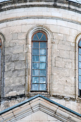 Old beautiful Windows in a large stone house.