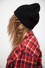 Blonde Girl Wearing Black Beanie & Red Checker Blouse