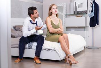 Husband calming upset wife after dispute
