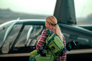 Woman Taking A Helicopter Hiking Tour In The Remote Deserts Of The Utah Canyonlands