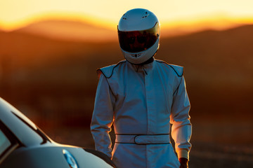 Printed roller blinds F1 A Helmet Wearing Race Car Driver In The Early Morning Sun Looking At His Car Before Starting