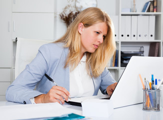 Lady business adviser working at office