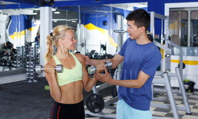 Couple during weightlifting workout