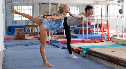 Fitness couple doing exercises in gym