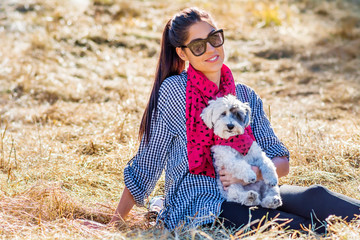 Beautiful Smiling Woman Hugging  Her Cute Havanese Dog with Red Scarf .Fashion for Owner and Dog .