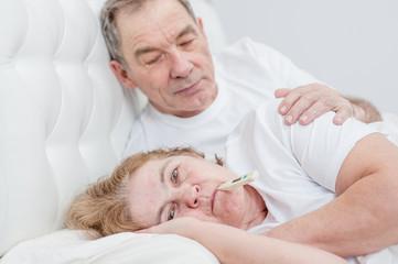 Elderly man takes care of an senior woman