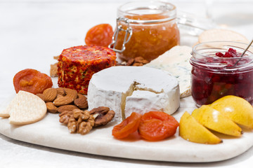 assortment of snacks, cheeses, nuts and fruits