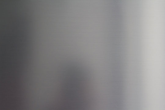 clean silver stainless steel background and texture, grey metal wall