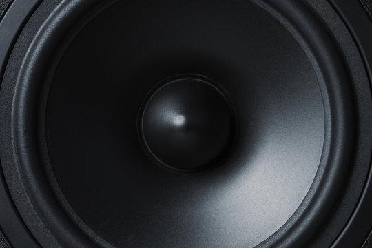 membrane sound speaker on black background, close up
