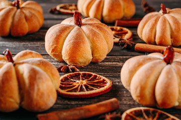 Homemade cakes in shape of pumpkin on a dark wooden background