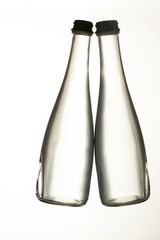 Two transparent glass bottles. White isolated background.