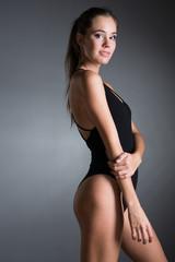 Beautiful young woman in black bodysuit