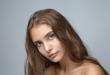 portrait of a young beautiful girl with long hair and natural make-up