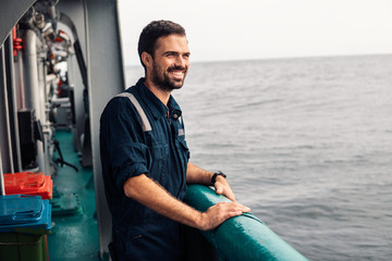 Marine Deck Officer or Chief mate on deck of vessel or ship . Marine life. He is smiling