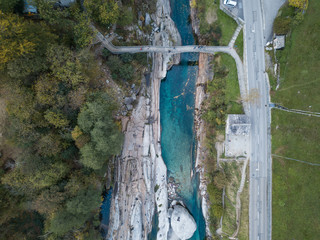 Aluminium Prints Dam Aerial drone shot from above of hiking Trail at the famous Roman Bridge called Ponte dei Salti in Lavertezzo,Verzasca Valley,Ticino Canton,Switzerland