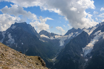 Closeup view mountains scenes in national park Dombai, Caucasus, Russia, Europe. Summer landscape, sunshine weather, dramatic blue sky and sunny day