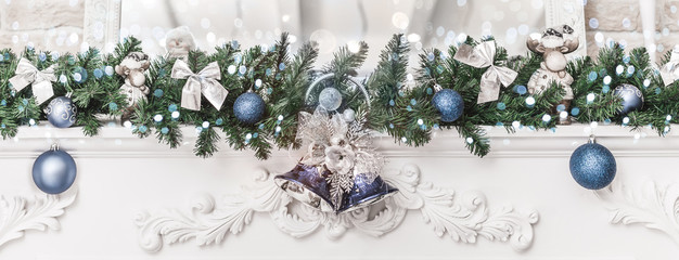 Christmas decorations with bells and balls, sparking, glowing holiday background. Happy New Year and Xmas theme