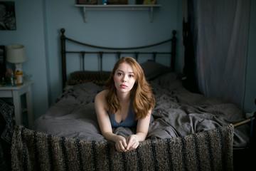 Sad girl on bed