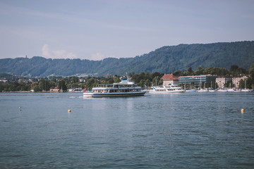 View on lake Zurich and mountains scenes, Zurich, Switzerland, Europe. Sunshine weather, dramatic moody blue color sky. Colorful summer day, evening time