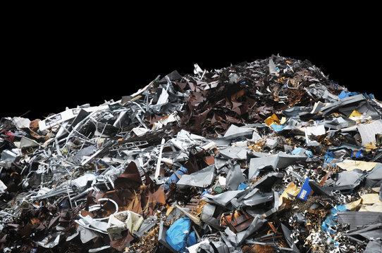 Pile of metal trash on a black background