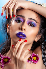 young Arabic beauty model with beautiful hair and dark blue lips
