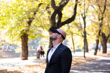Businessman have fun with Virtual Reality VR Headset BOX
