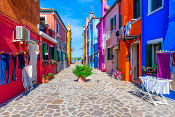 Street with colorful buildings in Burano island, Venice, Italy. Architecture and landmarks of Venice, Venice postcard Wall mural