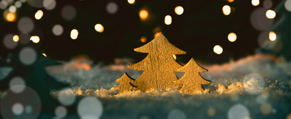 Wooden Christmas Trees, Snow, Magic Lights And Bokeh Background