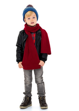 Little boy in a hat and scarf.