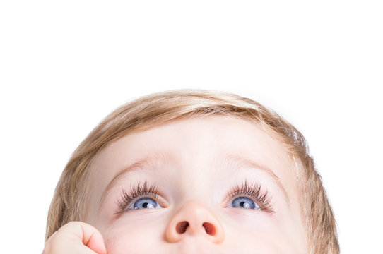 Adorable little boy looking up on a white background