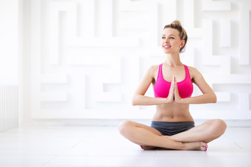 Young woman in a lotus position.