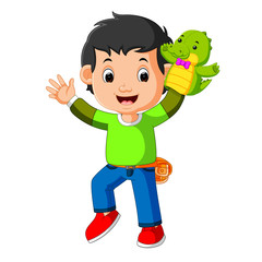 the happy boy was using crocodile puppet