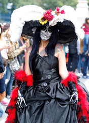 "A woman with her face painted as ""Catrina"" waits before taking part in a Catrina parade ahead of the Day of the Dead in Mexico City"