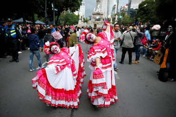 "Women dressed as ""Catrina"" wait before taking part in a Catrina parade ahead of the Day of the Dead in Mexico City"