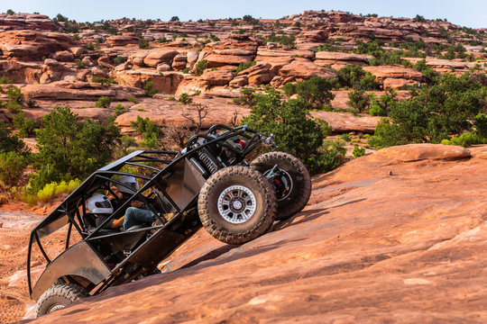 A Custom 4x4 Rock Crawler Off-Roading In The Sandstone Red Rock Terrain Outside Of Moab Utah In The American Southwest