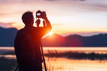 Silhouette of a photographer like to travel and photography