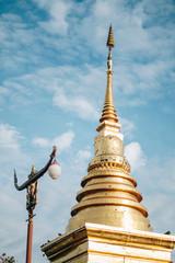 gold pagoda at Wat Phra That Chang Kam Worawihan at Nan National Museum, Nan, Thailand