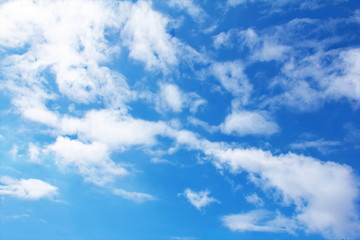 Abstract fluffy clouds pattern on blue sky at daylight on summer season background