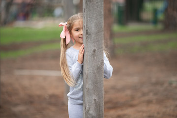 Happy child has fun on a rope eco playground