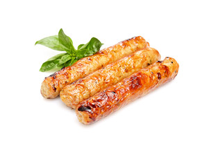 grilled juicy sausages on white background