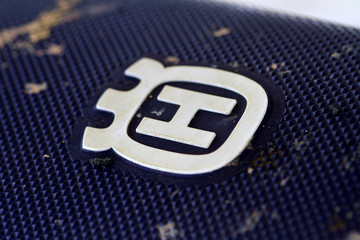 The Husqvarna logo is seen on the seat of a motorcycle in Johor
